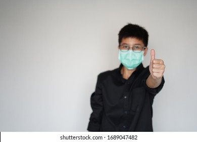 Young man wearing face hygienic  mask for prevention global coronavirus pandemic outbreak. His hand touch head, he stain because  infected Covid-19