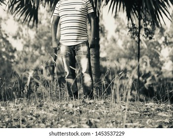 Young man wearing faded jeans standing in a place