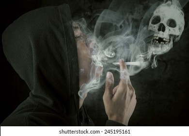 Young man wearing jacket smoking over a black background, shot in the studio