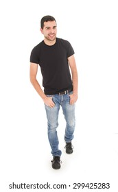 young man wearing jeans and black t-shirt posing isolated over white