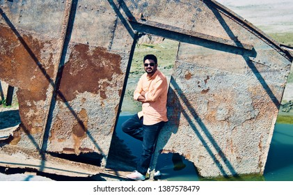 Young man wearing jeans standing in a place unique photo