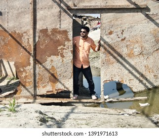 Young man wearing jeans standing in an abandoned place