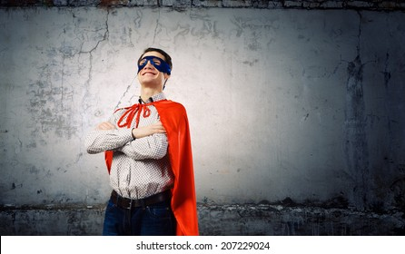 Young man wearing a mask and cape