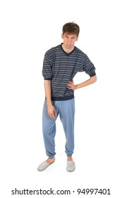 Young man is wearing pajamas and slippers