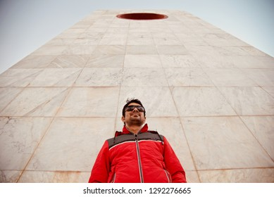 Young man wearing a red jacket standing in a place