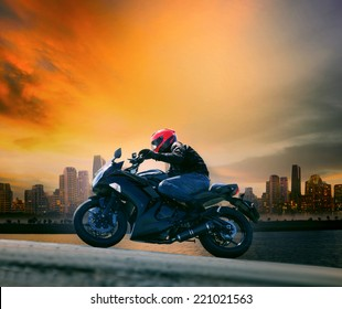 young man wearing safety suit riding big motorcycle  people activiteis theme