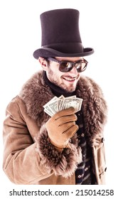 a young man wearing a sheepskin coat and a top hat isolated over a white background holding banknotes
