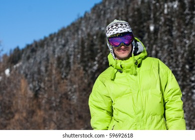 Young man wearing ski mask and sport jacket. Winter vacation in Alps