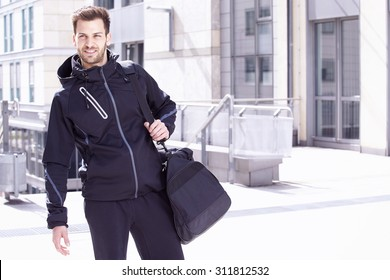 Young man wearing sports wear and bag, Madgeburg, Germany