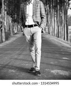 Young man wearing stylish dress standing on a concrete surface