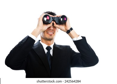 a young man wearing a suit with binoculars