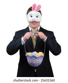 Young man wearing suit with Easter Bunny mask, holding an Easter basket full of brightly coloured eggs.
