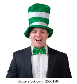 Young man wearing suit with green bow tie and green novelty hat for St. Patrick's Day. Isolated