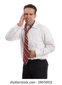 A young man wearing a suit and tie is suffering from a stomach ache and a headache at the same time, isolated against a white background