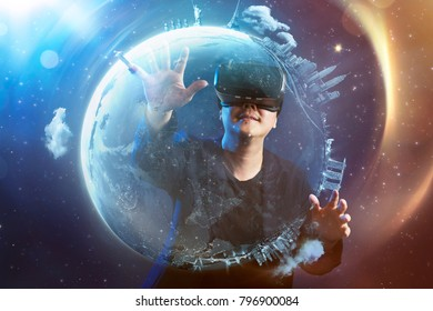 The young man wearing virtual reality goggles with amazing cosmic futuristic space virtual imaging background .