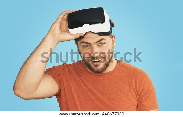 Young man wearing virtual reality goggles. Analog Film emulation-style