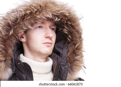 Young man wearing winter jacket isolated over white