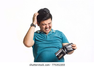 Young man well dressed with empty wallet broke no money.