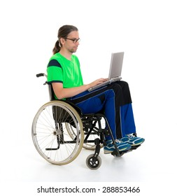 young man in a wheelchair in front of white background with computer