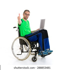 young man in a wheelchair in front of white background with computer and thumb up