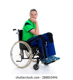 young man in a wheelchair in front of white background is sad