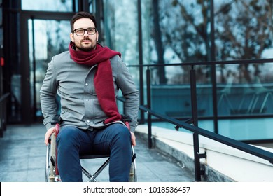 Young man in the wheelchair in a hurry going somewhere