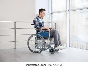 Young man in wheelchair indoors
