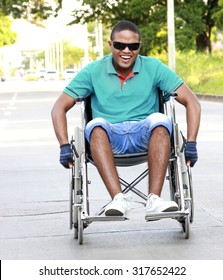 young man in a wheelchair outside