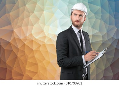 Young man in white hardhat, builder in formal wear