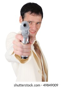 A young man in a white suit with a pistol shooting