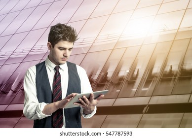 Young man who works using tablet and mobile