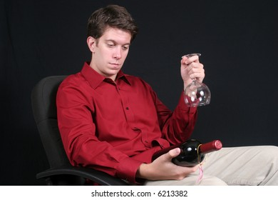Young man with wine