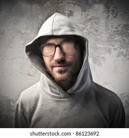 Young man without eyes behind his eyeglasses