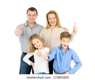 Young man, woman, boy and girl as a family. They are happy and smiling. Photo on the white background.