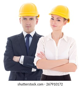 young man and woman in builder 's helmets isolated on white background