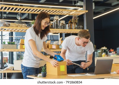 Young man and young woman checking stock levels