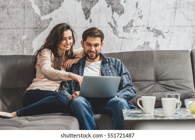 Young man and woman entertaining with computer