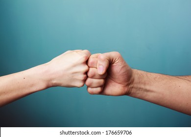 Fist bumping images stock photos vectors shutterstock young man and woman are fist bumping m4hsunfo
