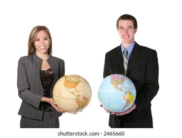 A young man and woman holding globes against a white background