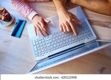 young man and woman with laptop