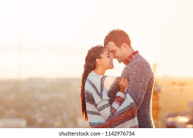 Young man and woman in love outdoors on the roof Love and relations concept