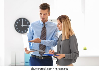Young man and woman in office