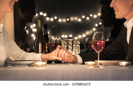 Young man and woman on a romantic date night sitting at a restaurant table