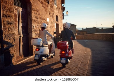 Young man and woman on Vespa Scooter. Bikers couple.