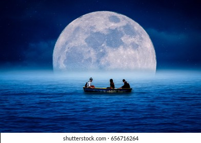 A young man, a young woman, paddling in the sea at night, with the moon falling beautifully.