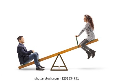 Young man and woman playing on a seesaw isolated on white background