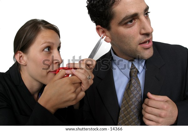 young man and woman with scissors