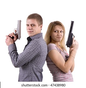 young man and woman standing back to back with the pistols in their hands