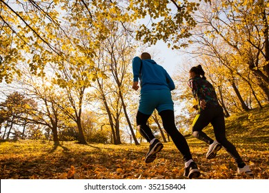 Young man and woman together running concept for exercising, fitness and healthy lifestyle