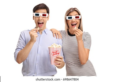 Young man and woman wearing 3D glasses and eating popcorn isolated on white background